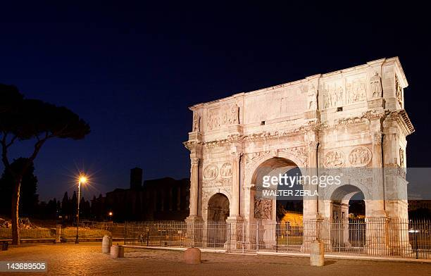 Arch of Constantine lit up at night