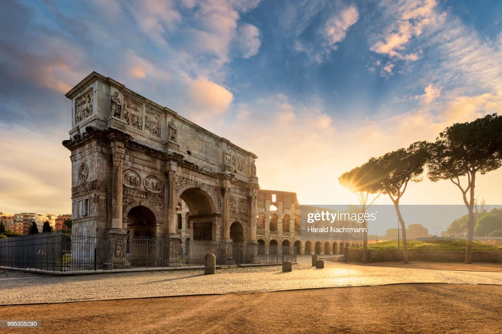 Arch of Constantine with the Colosseum in the background at sunrise, Rome, Lazio, Italy : Stock Photo