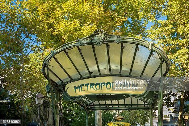 Arch of Parisien metro with metro sign