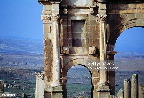 Arch on the side of the Arch of Trajan 1st2nd century AD detail ruins of the Roman city of Timgad founded in ca 100 AD by order of Trajan Algeria
