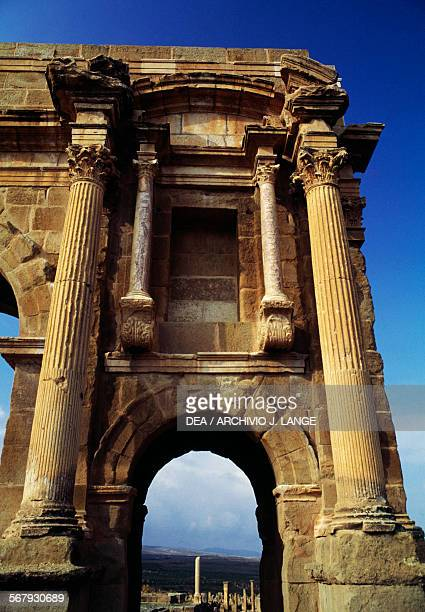 Arch on the side of the Arch of Trajan 1st2nd century AD ruins of the Roman city of Timgad founded in ca 100 AD by order of Trajan Algeria