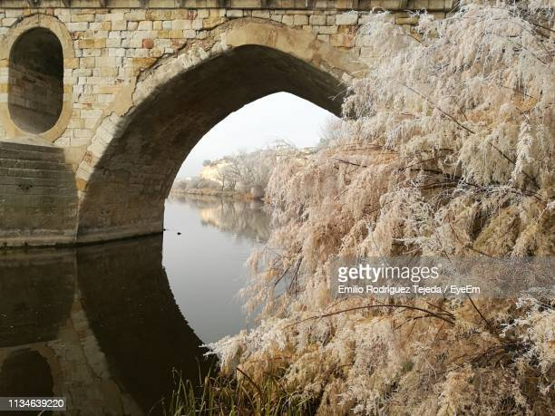 Arch Over Calm Canal During Winter