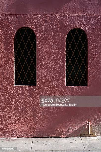 Arch Windows On Building Wall