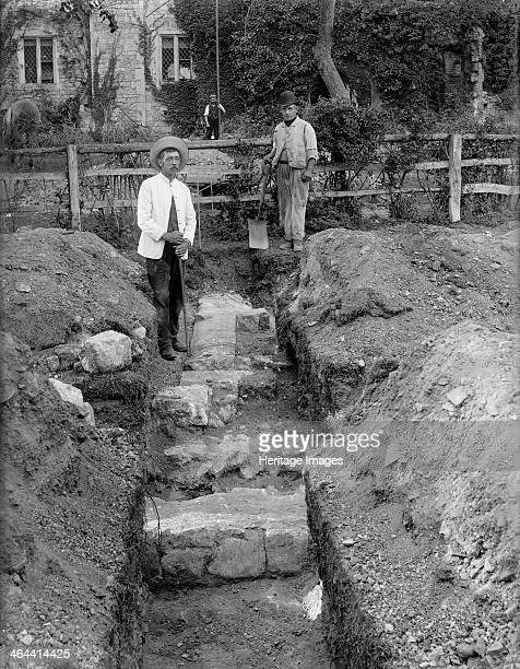 Archaeological excavations on this site of the refectory of Netley Abbey Hound Hampshire c1860c1922 Two excavators pose in the trench