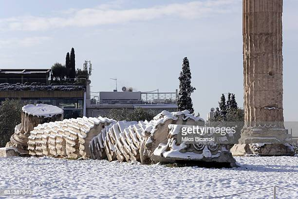 Archaeological site of the ancient Temple of Zeus is covered in snow on January 10 2017 in Athens Greece Schools in Athens remained closed on Tuesday...