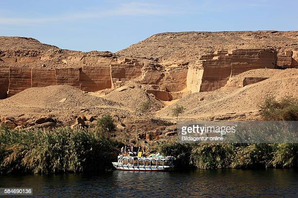 Archaeological sites in El - Kula on the Nile, in front of a pleasure boat, between Esna and Edfu, Africa, Upper Egypt.