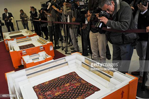 Archaeological textile pieces repatriated from Gothenburg Sweden are displayed at the Antropology Museum in Lima on June 16 2014 The Peruvian...