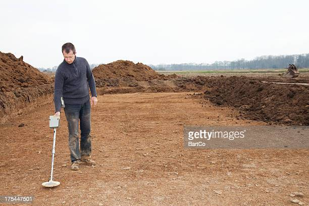 archaeologist at excavation site - metal detector stock photos and pictures