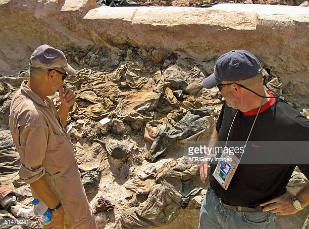 Archaeologist Michael Trimble and Greg Kehoe a US lawyer appointed by the White House to work with the Iraqi Special Tribunal view a mass grave site...