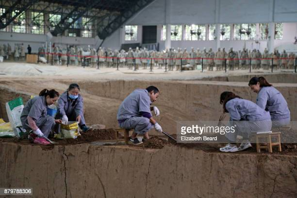 Archaeologists at work at the terra cotta warriors dig site, Xian