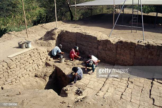 Archaeologists at work on the excavation of the temple-tomb pyramid at Sipan, Lambayeque Valley, Several gold-rich burials of high- ranking Moche...