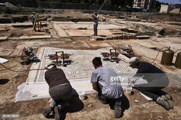 Archaeologists carry out searches on a mosaic on July 31 on the archaeological antiquity site of SainteColombe near Vienne eastern France Remains of...