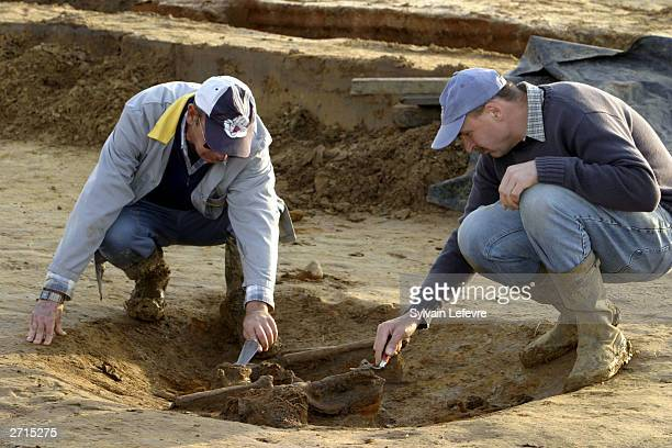 Archaeologists clean the remains of an unidentified soldier of the Fifth Battalion Northumberland Fusiliers on November 10, 2003 in Ypres, Belgium....