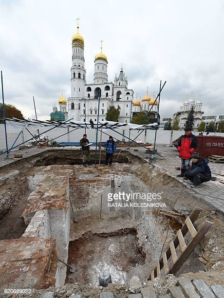 Archaeologists dig during excavation work at the site of a dismantled 1930sera Kremlin administration building known as the 14th wing in central...