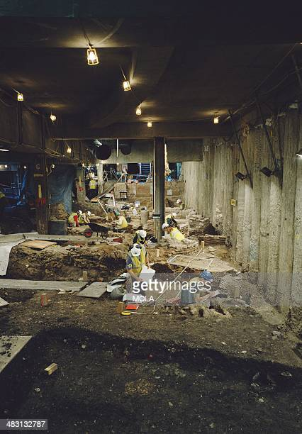 Archaeologists excavating and recording late Roman buildings during the main phase of excavation at 1 Poultry City of London 1994