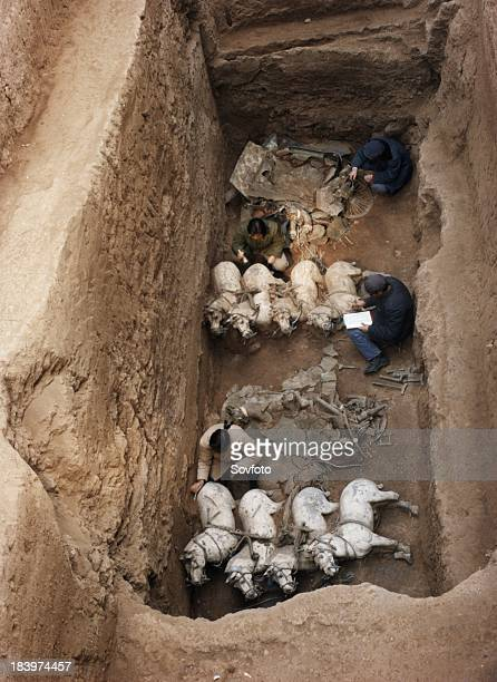 Archaeologists excavating terracotta warriors and horses at the tomb of the first emperor of China Qin Shi Huang Ti in Xian China