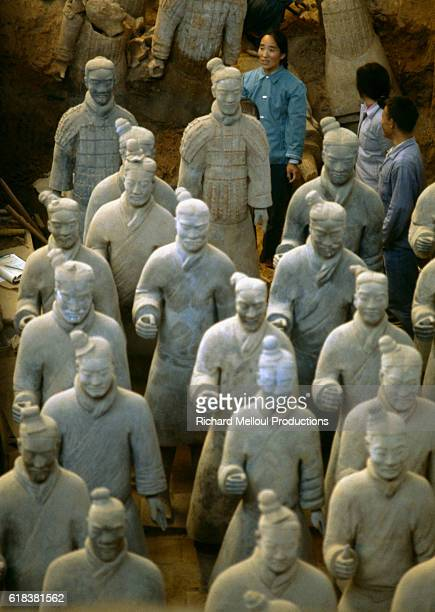 Archaeologists stand among the terracotta warriors at the Qin Shi Huangdi mausoleum in Xian | Located in Mausoleum of Qin Shi Huangdi