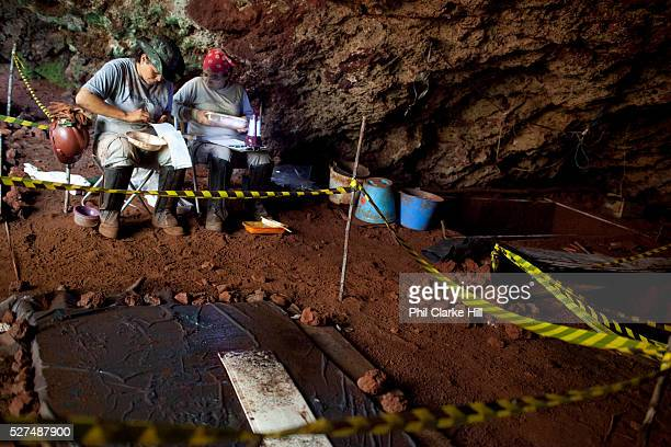 Archaeologists surveying a cave site in the Carajas national forest an unique type of svaanna deep in the rainforest The Carajas Open Cast Iron Ore...