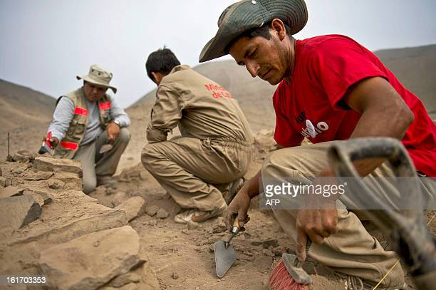 Archaeologists work at the El Paraiso archaeological site in Lima on February 14 2013 An ancient temple believed to be about 5000 years old was...