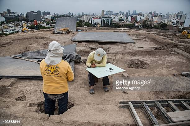 Archaeologists work at the Huaca Pucllana archaeological site in Lima Peru on November 30 2015 The team of archaeologists from the Huaca Pucllana...