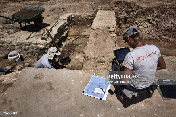 Archaeologists works on July 31 on the archaeological antiquity site of SainteColombe near Vienne eastern France Remains of an entire neighbourhood...