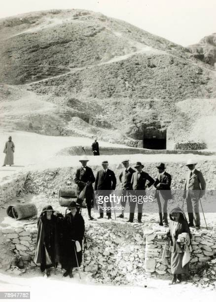 1922 British archaeologist Howard Carter and Lord Carnarvon amongst a group outside the steps leading to the intact tomb of King Tutankhamen