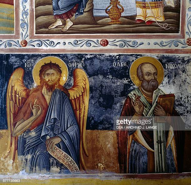 Archangel and saint frescoed vault in Mikro Sotiris monastery Symi island Greece