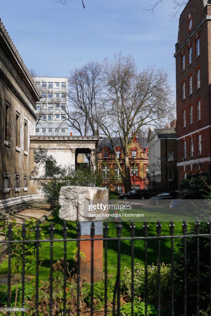 Archangel Michael sculpture in St. Pancras New Churchyard - London, England : Stock Photo