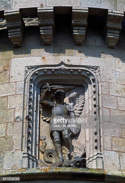 Archangel Michael slaying the dragon basrelief on the north tower of Chateau de Bonnefontaine Antrain Brittany France