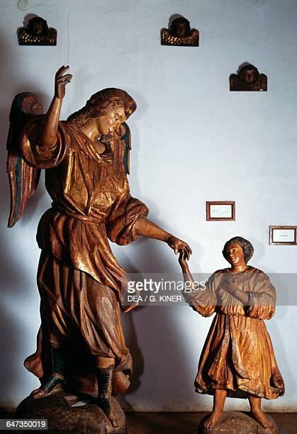 Archangel Raphael and young Tobias polychrome wooden sculpture Guarani Baroque style San Ignacio Guazu Misiones Paraguay