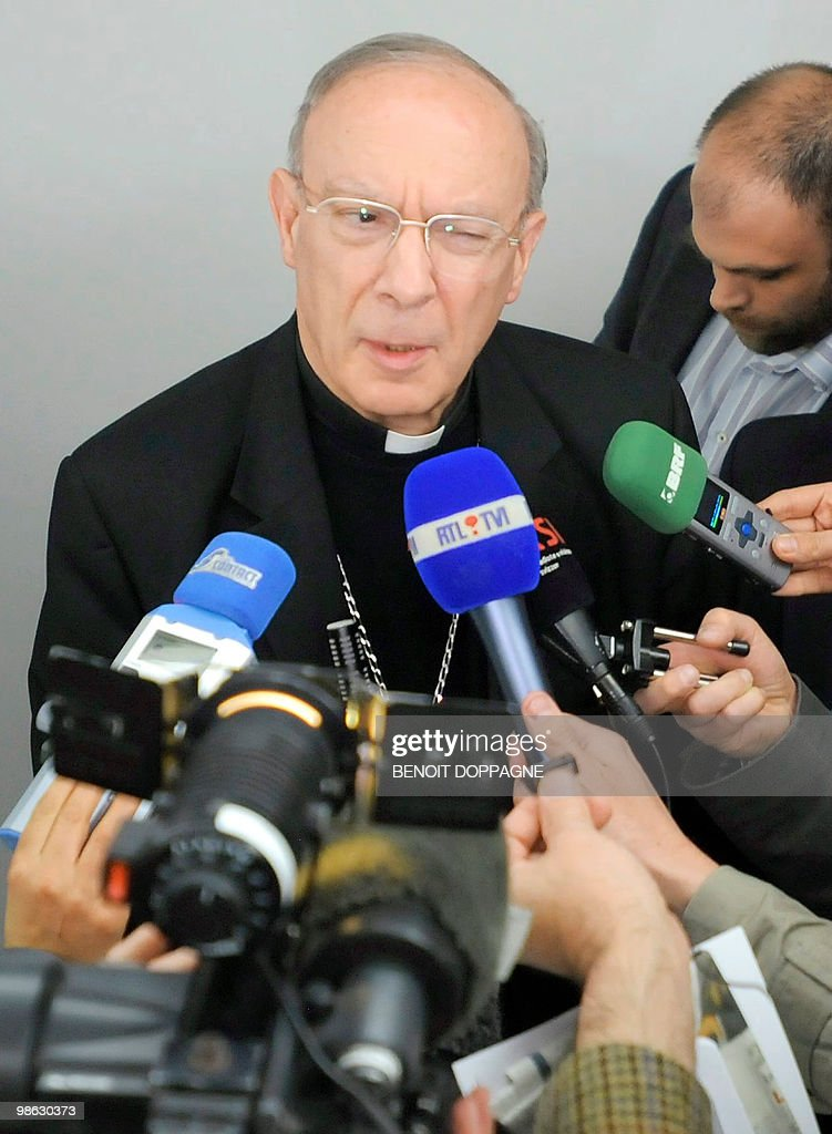 Archbishop Andre-Joseph Leonard talks to the press after a press conference regarding the resignation of Brugge's bishop Roger Vangheluwe (not present), in Brussels, on April 23, 2010. Vangheluwe has resigned after admitting sexually abusing a young boy several years ago, the Roman Catholic Church in Belgium announced.