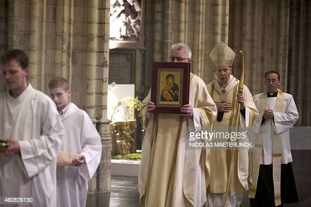 Archbishop AndreJoseph Leonard walks during the celebration of the Midnight mass on Christmas eve at the St Michael and St Gudula Cathedral in...