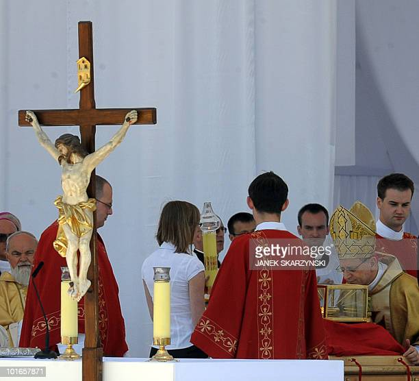 Archbishop Angelo Amato the Vatican's Prefect of the Congregation for the Causes of Saints kisses on June 6 2010 the relics of Jerzy Popieluszko a...