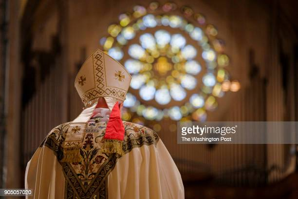 Archbishop Carlo Maria Vigano the Vatican's ambassador to the US reads a sermon about foot washing at the Basilica of the National Shrine of the...