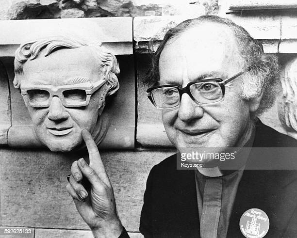 Archbishop Designate of Canterbury Reverend Robert Runcie Bishop of St Albans pictured next to a stone head in his own likeness on the roof of St...