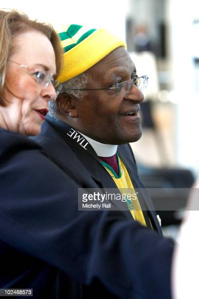 Archbishop Desmond Tutu and Ann Moore, CEO Time Inc, attend the TIME/FORTUNE/CNN Global Forum at the Cape Town International Convention Centre on...