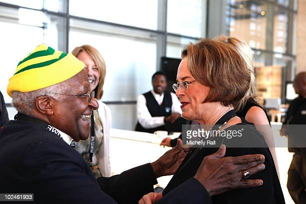 Archbishop Desmond Tutu greets Ann Moore, CEO Time inc at the TIME/FORTUNE/CNN Global Forum at the Cape Town International Convention Centre on June...