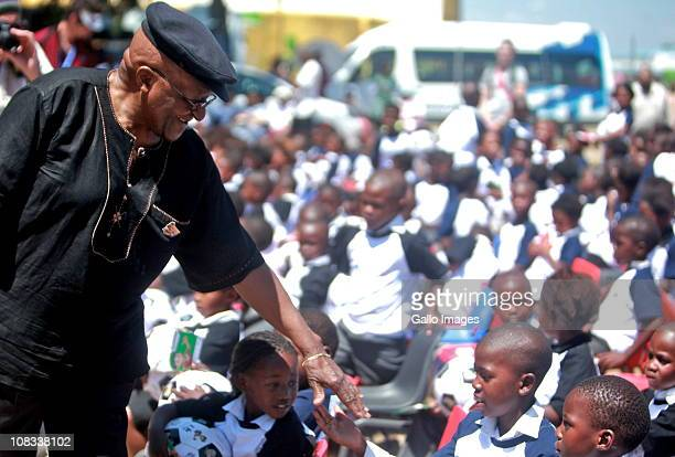 Archbishop Desmond Tutu meets pupils of Andile Primary School as part of a tuberculosis awareness and prevention campaign on January 25 2011 in...