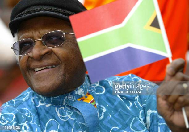 Archbishop Desmond Tutu waves the South African flag in London's Trafalgar Square during celebrations for South Africa's 10th Freedom Day 27 April...
