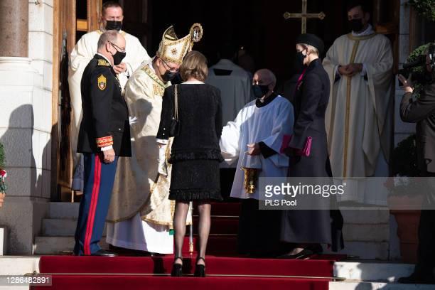 Archbishop Dominique-Marie David greets Princess Caroline of Hanover, Prince Albert II of Monaco and Princess Charlene of Monaco as they arrive at...