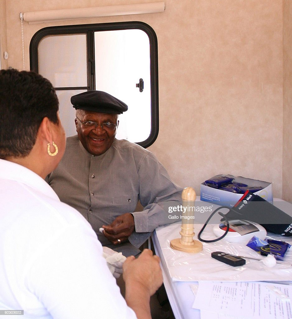 Archbishop Emeritus Desmond Tutu talks to nurse Liz Thebus during the launch of his new HIV mobile clinic, the 'Tutu Tester' at Milnerton on October 22, 2009 in Cape Town, South Africa. The 'Tutu Tester' provides diabetes and HIV testing as well as counselling.