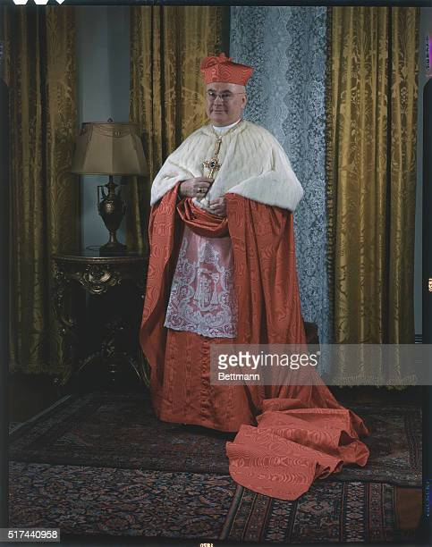 Archbishop Francis J Spellman poses in his Cardinalate robes vestments formerly worn by the late Cardinal Hayes for the first time at the...