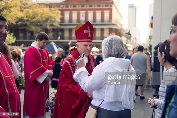 Archbishop Gregory Michael Aymond of the Archdiocese of New Orleans greeting parishioners after Good Friday Mass in front of the St. Louis Cathedral...