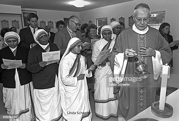 Archbishop John Donoghue blesses a new Aids hospice home in Atlanta, Georgia shortly after the Missionaries of Charity opened the home in midtown...