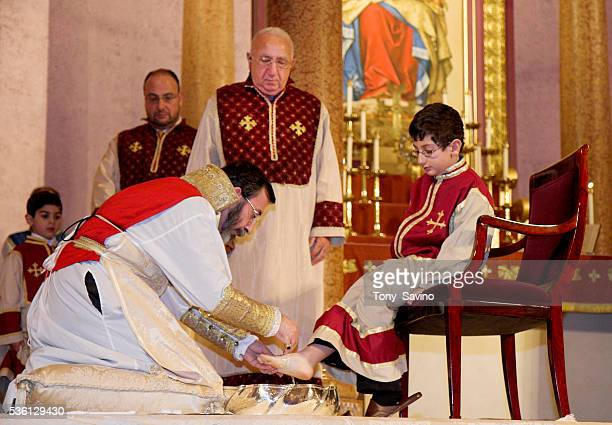 Archbishop Khajag Barsamian Primate of the Diocese of the Armenian Church of America celebrates the Washing of the Feet Service on Holy Thursday at...