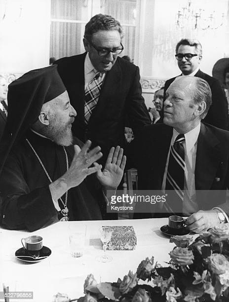 Archbishop Makarios diplomat Henry Kissinger and President Gerald Ford talking together at the Helsinki Peace Conference Finland circa 1975