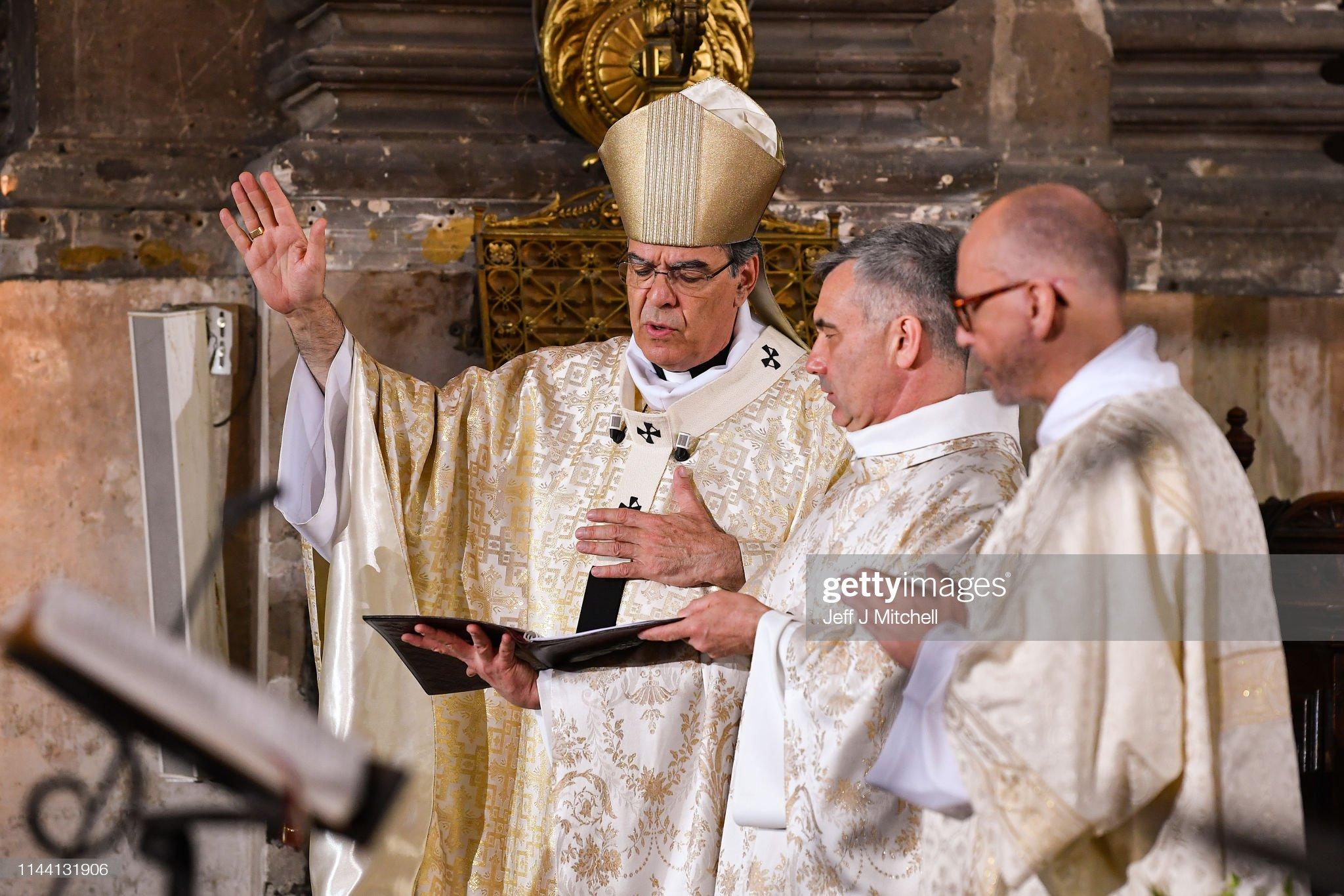https://media.gettyimages.com/photos/archbishop-michel-aupetit-leads-notre-dame-easter-mass-at-the-church-picture-id1144131906?s=2048x2048