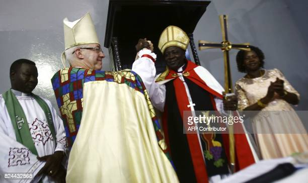 Archbishop of Canterbury Justin Welby and Ezekiel Kondo Kumir Kuku Sudan's newly appointed first archbishop attend a ceremony in Khartoum's All...