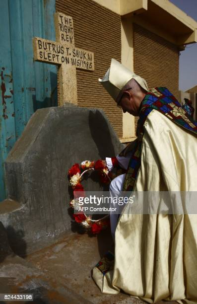 Archbishop of Canterbury Justin Welby lays a wreath on the grave of former bishop Butrus Shukai at Khartoum's All Saints Cathedral following a...