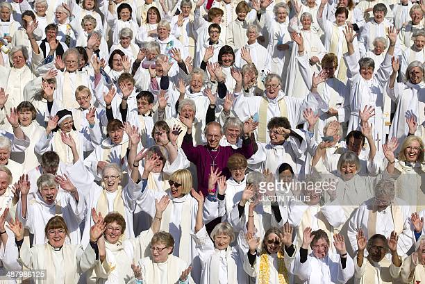 Archbishop of Canterbury Justin Welby poses for pictures with women priests on the steps of St Paul's Cathedral in London, on May 3 to mark the...